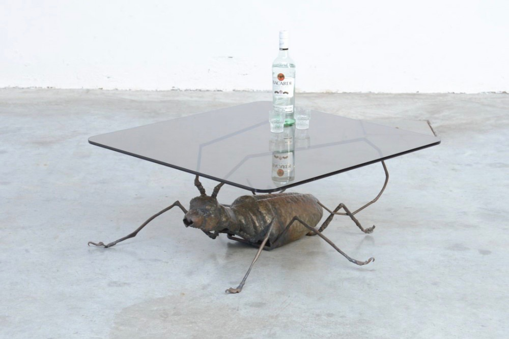 unique-coffee-table-handcrafted-metal-cricket-sculpture-base