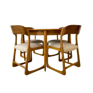 Traineau sledge chairs and round extensible table by Emile & Walter Baumann
