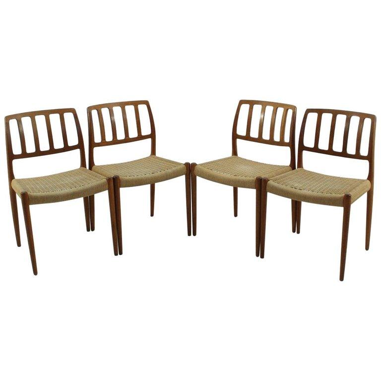 Vintage Model 83 Teak Dining Chairs by Nils O. Møller for J.L. Møllers, Set of 4