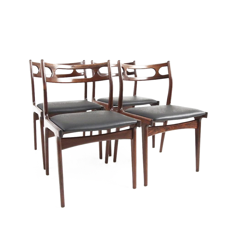 A nice set of four dining chairs in rosewood designed by Johannes Andersen in 1967
