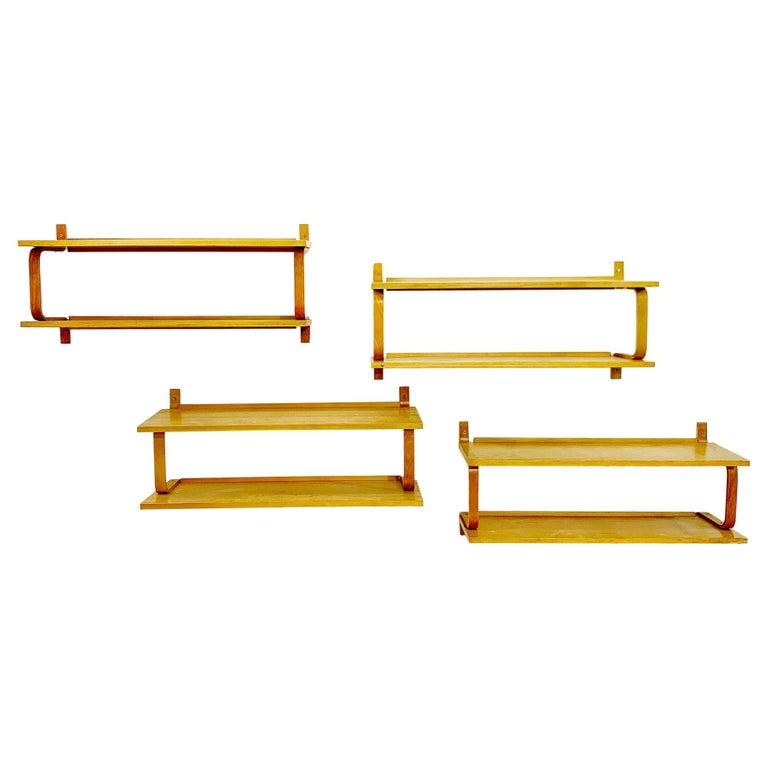 Set of four wall shelves by Alvar Aalto