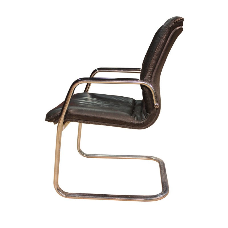 Designer armchair in plastic and fake leather