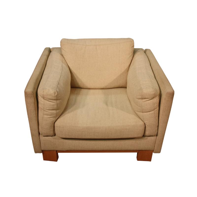 Design armchair in light fabric