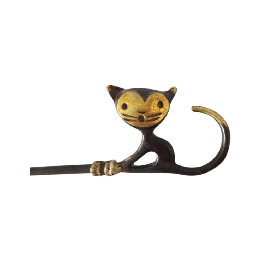 Walter Bosse shoehorn cat made of brass for Herta Baller