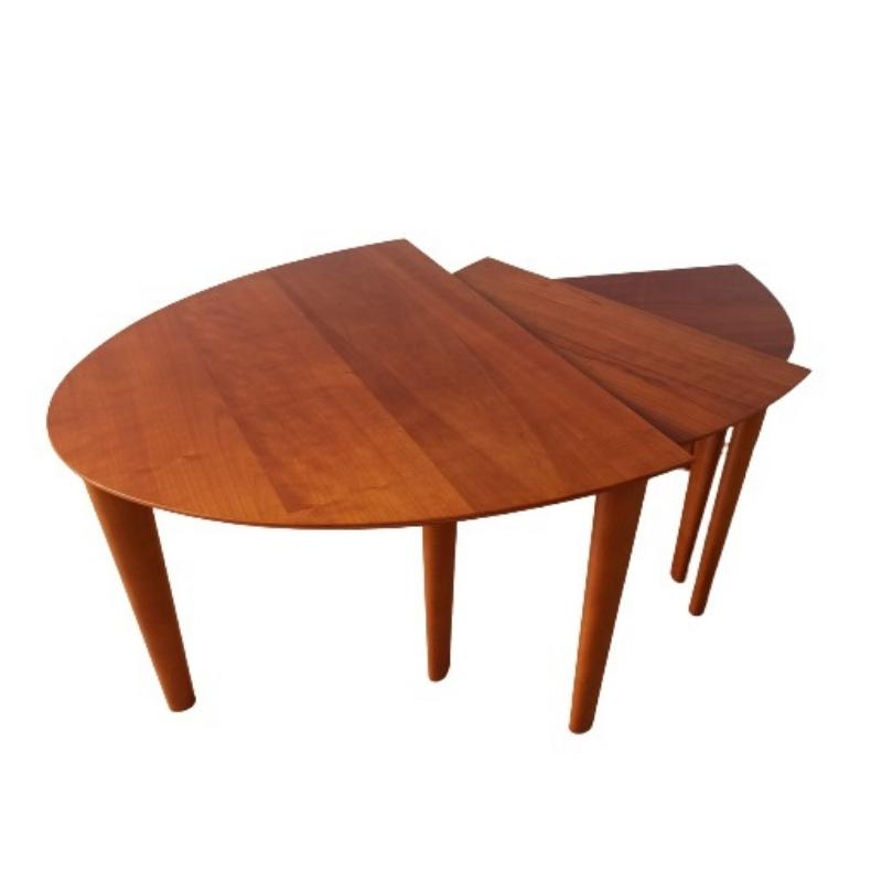 A set of three designer teak tables.